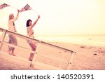 woman on the beach at sunset ... | Shutterstock . vector #140520391