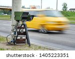 Small photo of Mobile speed camera on highway. Police radar installed on roadside to control speed limit. Police radar on the road. Automatic radar photographs cars driving too fast