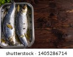 Stock photo salted herring in sea salt with spices in containers on wooden background dry salting 1405286714