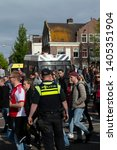 police controlling crowd at... | Shutterstock . vector #1405351904