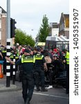 police controlling crowd at... | Shutterstock . vector #1405351907