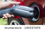 electric vehicle plugging in   Shutterstock . vector #140537695