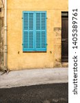 closed blue shutters on a... | Shutterstock . vector #1405389761