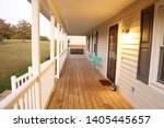 long front porch covered with a ... | Shutterstock . vector #1405445657