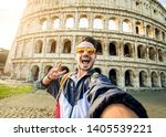 Stock photo happy tourist man taking a selfie in front of colosseum in rome italy 1405539221