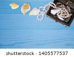 wooden chest with beads and... | Shutterstock . vector #1405577537