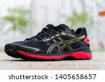 Small photo of Bangkok, Thailand - May 4, 2019 :ASICS Running Shoes GT-2000 7 on rock concrete, ASICS is a Japanese multinational corporation athletic equipment company which produces footwear and sports equipment