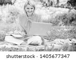woman with laptop sit on rug... | Shutterstock . vector #1405677347