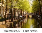 Amsterdam With  Green Canal In...