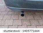 car exhaust pipe smoke fumes | Shutterstock . vector #1405771664