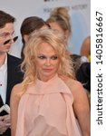 Small photo of ANTIBES, FRANCE. May 23, 2019: Pamela Anderson at amfAR's Gala Cannes event at the Hotel du Cap d'Antibes. Picture: Paul Smith / Featureflash