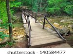Wooden Bridge In The Forest At...