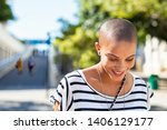 Stock photo portrait of happy and young bald woman smiling carefree trendy girl with bald head after cancer 1406129177