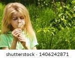 little blond girl blowing...   Shutterstock . vector #1406242871