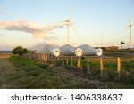 windmill farm for renewable... | Shutterstock . vector #1406338637