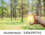 hand holding light bulb for... | Shutterstock . vector #1406390741