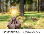 hand holding light bulb for... | Shutterstock . vector #1406390777