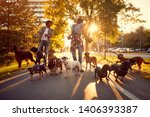 Stock photo happy girl and man dog walker with dogs enjoying in walk outdoors 1406393387