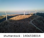windmills for electric power... | Shutterstock . vector #1406538014