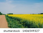 field of rapeseed with... | Shutterstock . vector #1406549327