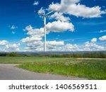 energy wind turbine on a field... | Shutterstock . vector #1406569511