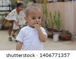 portrait of a young boy with an ... | Shutterstock . vector #1406771357
