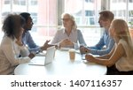 diverse businesspeople talk at... | Shutterstock . vector #1407116357