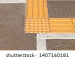 bright yellow tactile paving... | Shutterstock . vector #1407160181