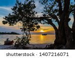 Small photo of ALTER DO CHAO, BRAZIL - CIRCA SEPTEMBER, 2018: Sunset in the waters of the Tapajos River seen from the Ilha do Amor, in Alter do Chao, state of Para