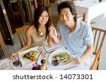 A Young Asian Couple Having...