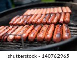 Several Cooking Hot Dogs On A...