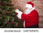 santa claus decorates a...   Shutterstock . vector #140769691