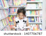 Asian Child Reading Or Kid Gir...