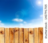 Wooden Fence Against Blue Sky...
