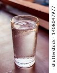 glass water drink with tube on... | Shutterstock . vector #1408047977