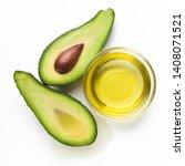 Halves Of Ripe Avocado And Oil...