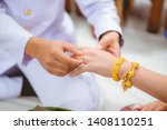 the groom wearing the wedding... | Shutterstock . vector #1408110251