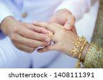 the groom wearing the wedding... | Shutterstock . vector #1408111391