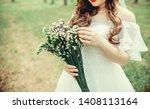 the bride touch her flower... | Shutterstock . vector #1408113164