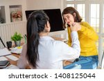 two cheerful woman giving high...