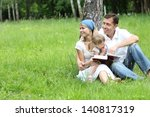 Young Family Reading The Bible...