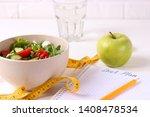 tape and lettuce on a light...   Shutterstock . vector #1408478534