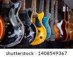 row of electric guitars in a... | Shutterstock . vector #1408549367