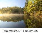 Sunrise On A Foggy Mountain Lake