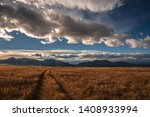 Dramatic clouds over the plains - stock photo