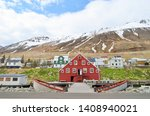 Stock photo red house rustic wood fishing village near herring era museum in siglufj r ur iceland 1408940021