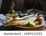 Stock photo mediterranean food smoked herring fish served with green onion lemon tomatoes green pepper olive 1409111231