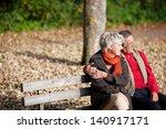 smiling senior couple sitting... | Shutterstock . vector #140917171