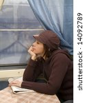 Small photo of Girl travel in passenger roomette