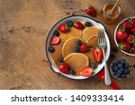 pancakes with fresh berry in... | Shutterstock . vector #1409333414